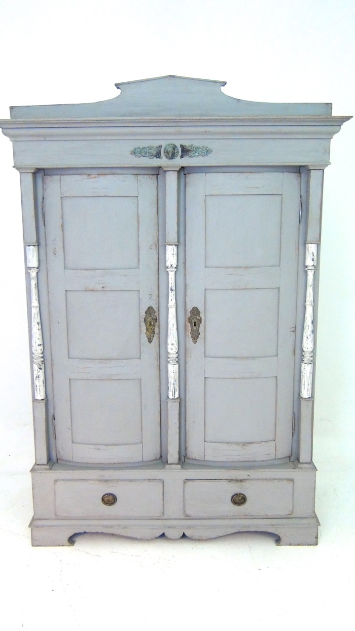 A Scandinavian two doors cabinet, with bronzes mounted, ca. 1820-30. Fine curved doors.