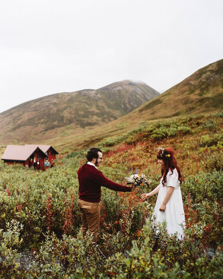 His sweater compliments her hair. White flow-y dress always a win!  GRACE+ALEX / Benj Haisch Photography  SO. Cute.