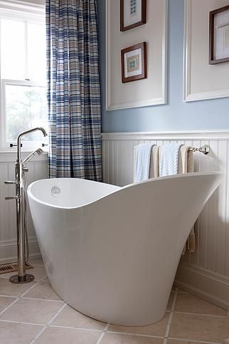 A great tub. Not too wide, but oh, so deep! Needs to go into room before standard door is built out. And look at the faucet...