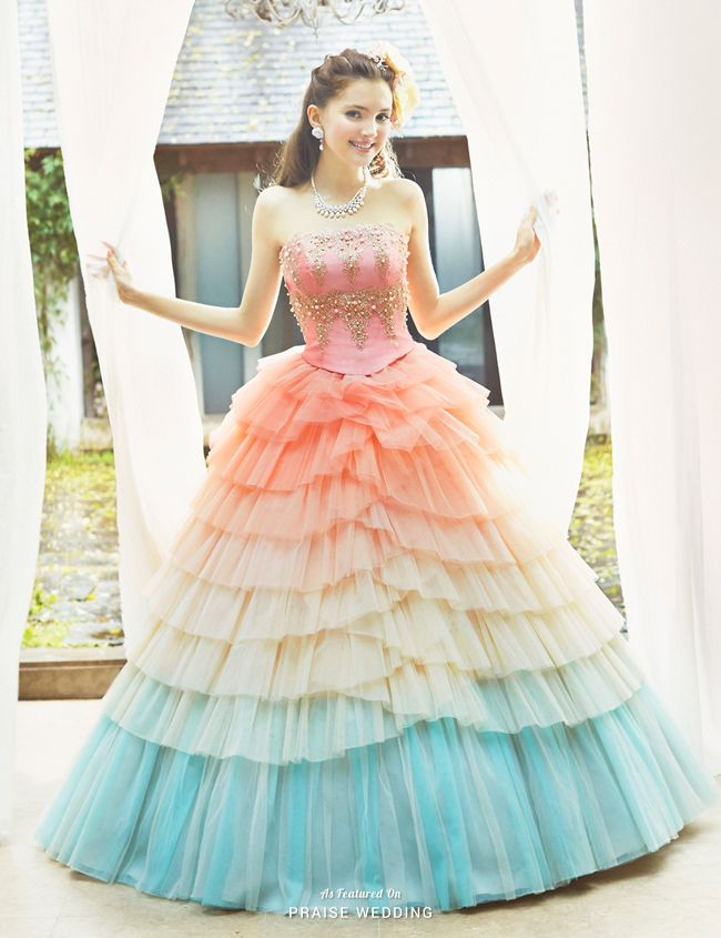 For the romantic bride at heart, nothing is sweeter than twirling in this pastel rainbow ball gown from Joyful Eli!