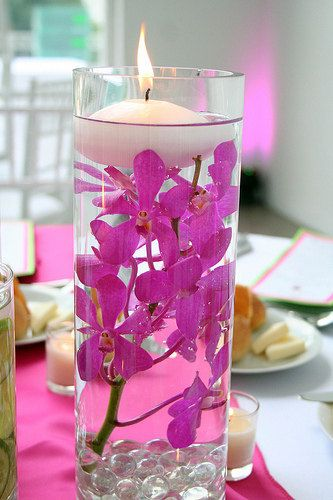 Floating candles..Distilled water + fake flowers + dollar store vases. I really like this idea!
