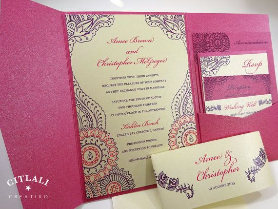 A pocket wedding invitation set featuring a floral henna pattern – housed in a metallic pocket folder in hot pink (many colors available). Invitation is
