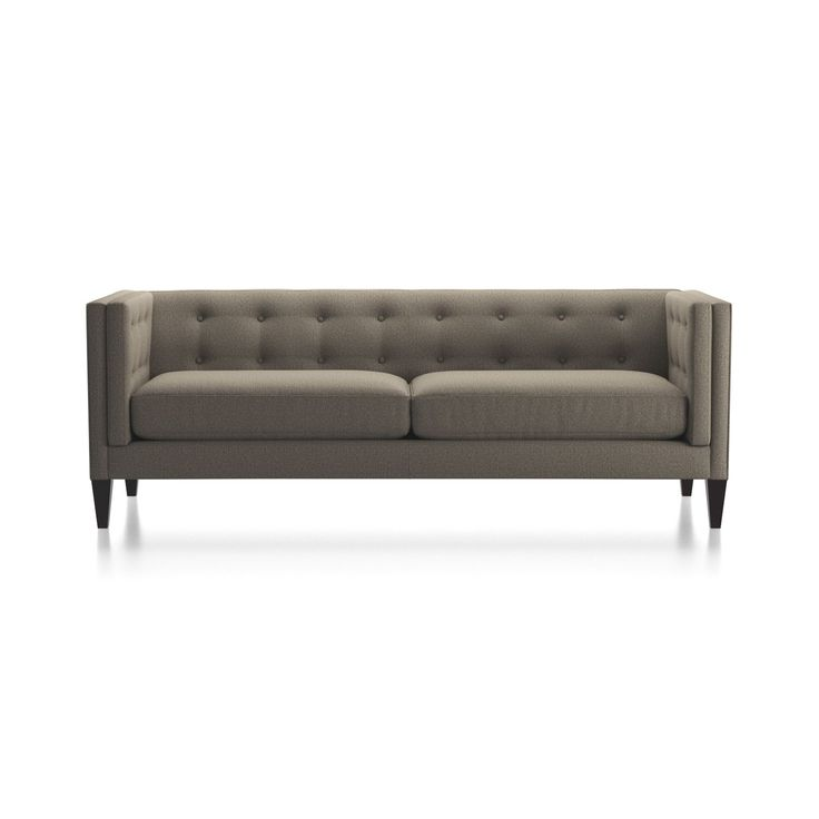 Shop Aidan Grey Tufted Sofa.   Upholstered in a bespoke herringbone synthetic fabric, this boutique-style sofa features a soft continuous button-tufted back and 2 firm seat cushions.  Aidan Sofa is a Crate and Barrel exclusive. Here's .
