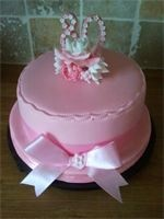Pink 80th Ribbon and Rose Birthday Cake : A pink fondant 80th fruit Birthday cake with handcrafted Rose, flowers and blossom posy. It also has a handcrafted 80 to match the colour scheme and large ribbon bow