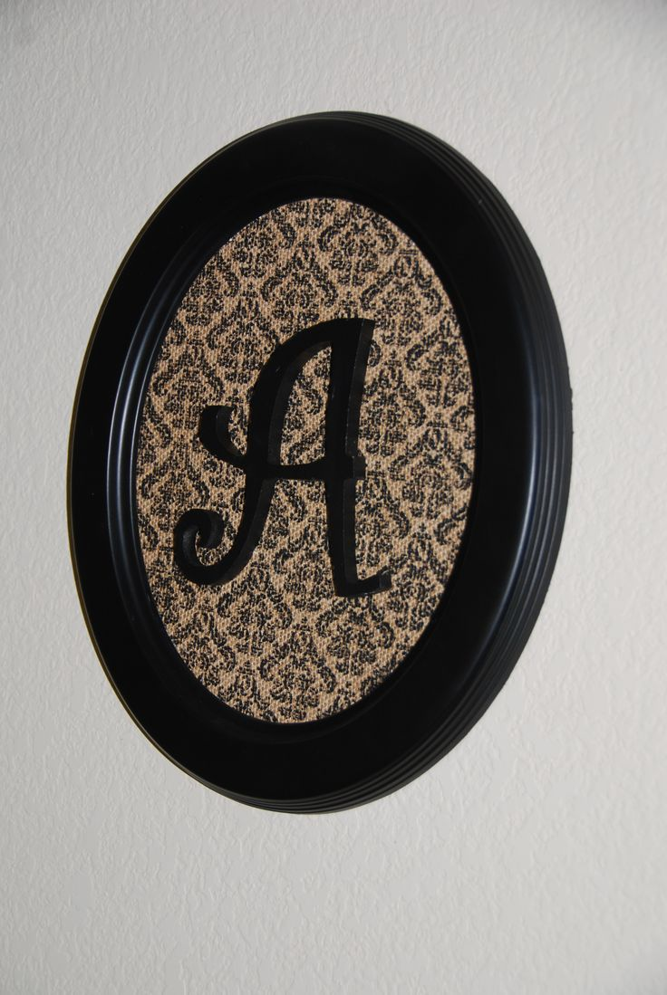 Transformed a clearance oval picture frame into a monogrammed hanging for my stairwell decor.  I simply replaced the picture area with a printed piece of burlap (found in the scrapbook section of Michaels) and hot glued a monogrammed wooden A on top.