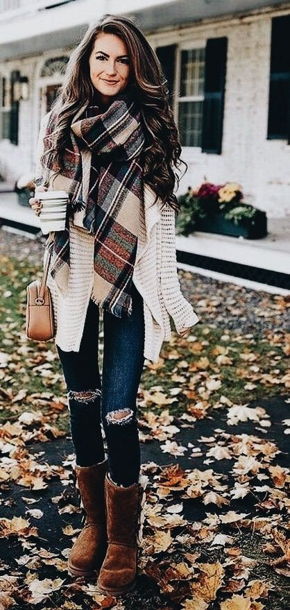 White cardigan with distressed jeans and cute plaid scarf.