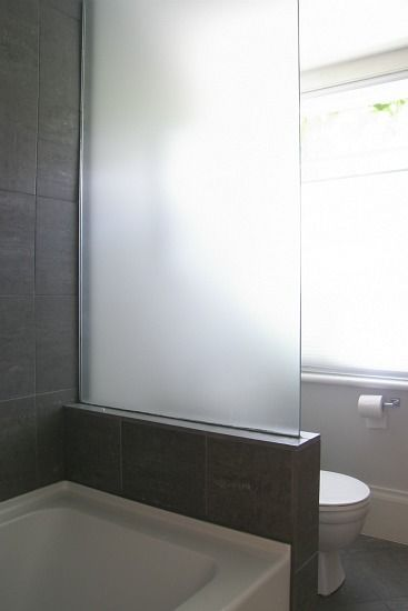 I like the frosted glass instead of wall here so there is more natural light as you are in the shower...smart...House Pretty Blog