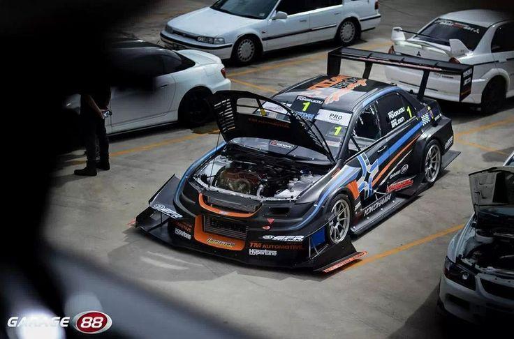 Mitsubishi lancer evolution time attack aero cars for Garage auto evo milizac