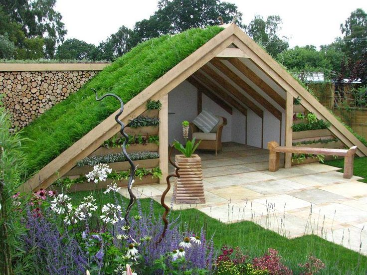 Nice take on a garden hideaway and a lovely roof...Would be great planted with chamomile....Who needs one of these for their gardens?  For other garden inspired hideaways here is a link to our pinterest board, Sheds, Huts and Hideaways.....  https://www.pinterest.com/growveg/sheds-huts-and-hideaways/.