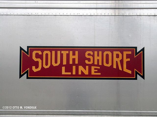 Logo for South Shore Line - The South Shore Line (reporting mark NICD) is an electrically powered interurban commuter rail line operated by the Northern Indiana Commuter Transportation District (NICTD) between Millennium Station in downtown Chicago and the South Bend International Airport in South Bend, Indiana. Freight service over the same route is operated by the Chicago South Shore and South Bend Railroad.