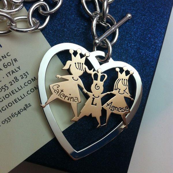 Pendente dolcissimo: cuore in argento con l'applicazione dei tre bimbi in oro rosa