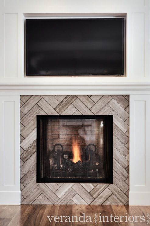 Herringbone tile pattern on fireplace
