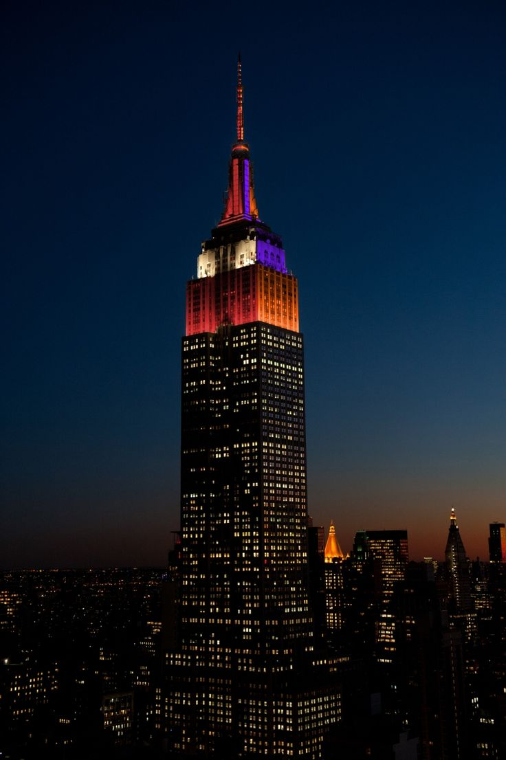 January 9, 2017: The Empire State Building wishes good luck to the University of Alabama and Clemson University ahead of the College Football Playoff National Championship by lighting in both team's colors.