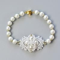 Do you love pearl bead bracelets? This article will show you how to make a handmade white pearl bead bracelet with bead flower decorated.