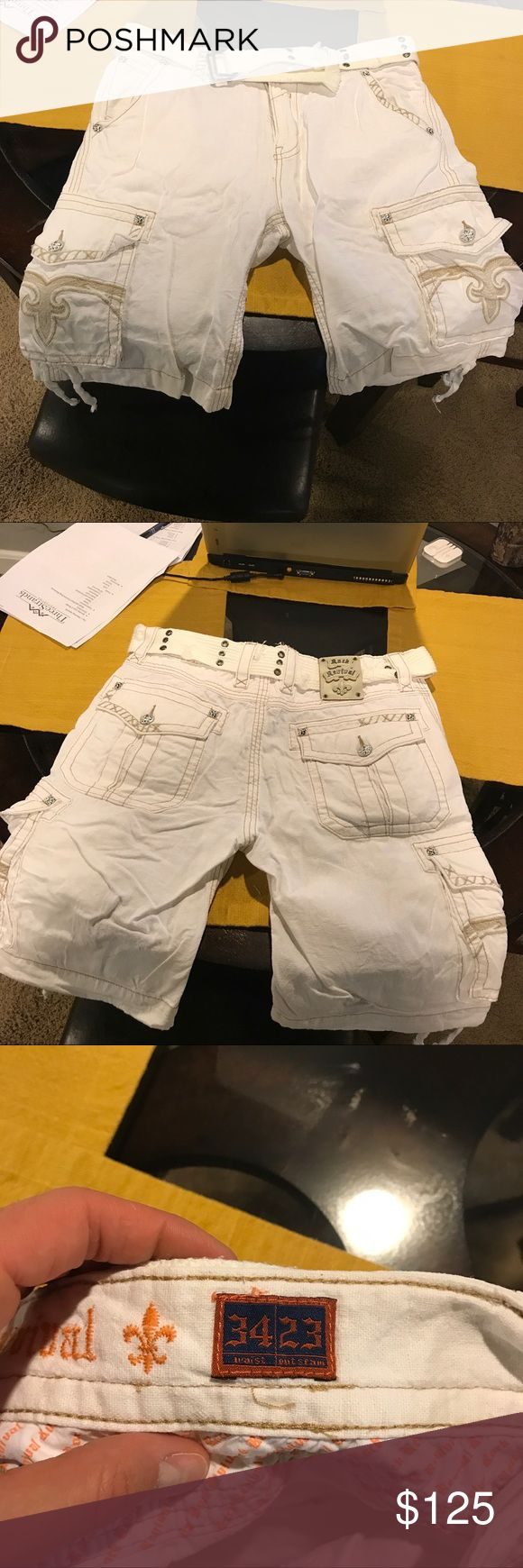 Men's size 34 waist white Rock Revival Shorts Men's waist size 34 outseam 23 white Rock Revival Shorts. Pretty much like brand new. Worn only a couple times. Comes with belt. Very light material and very comfortable stylish Shorts. Rock Revival Shorts Cargos