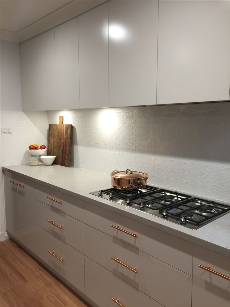 Our new kitchen! Clamshell Caesarstone, cabinetry in Dulux 'limed white quarter', splashback tiles from Southern Cross Ceramics 'infinity Brighton', copper T-bar drawer pulls/handles from Forge Hardware Studio via Etsy