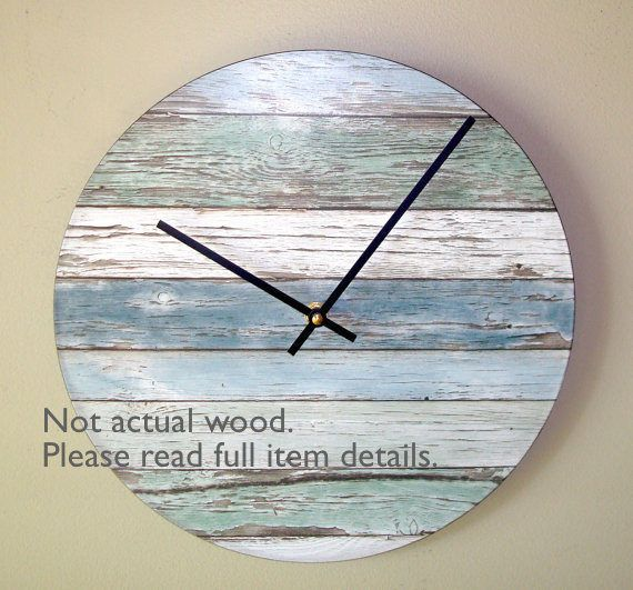 This wood pattern wall clock is made with a vinyl record as its base. The trending look of reclaimed wood is captured in this lovely wall decor and would fit in well with many home decor styles. Great clock for a beach house! Wooden numbers can be added as shown in the last photo. Makes a wonderful gift for yourself or someone special! ITEM DETAILS:  * 10 or 12 inches in diameter  * A recycled vinyl record serves as the base  * Designer paper image has been adhered to the record and sealed…
