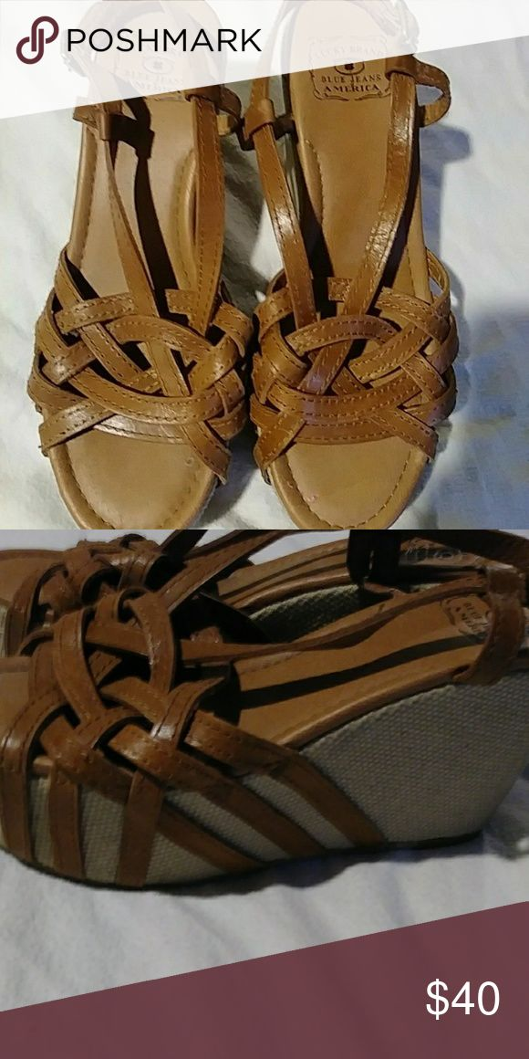 Lucky Brand Ladies Wedge Sandals These adorable brown wedge sandals by Lucky Brand are a size 8.  They will complete any outfit whether you are dressed up or down.  They are in almost perfect condition.  These will be an awesome addition to your shoe collection! Lucky Brand Shoes Wedges