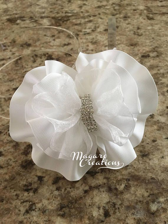 These are beautiful handmade headband and hair clip that would be perfect for 1st. communion, special occasions or just for a photo prop. 1/2 wide plastic headband. 2 3/4 long french barrette clip.  The bow measures aprox. 5 1/4 x 4  This listing is for one headband or hair clip in