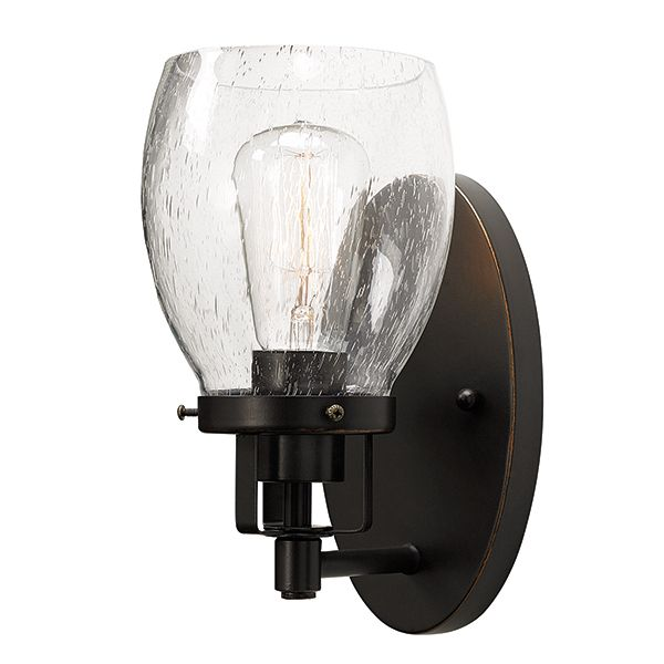This 1 light, java gold, clear seeded glass wall sconce is well suited for hallways, powder rooms, bathrooms, and master ensuites. As part of the Dayton family, the styling is reflective of a more traditional era, with reflections of early American gas lights with a softer masculine look. The clear seeded glass completes the look to give you a fixture that works in modern industrial homes as well as a more traditional craftsman home.