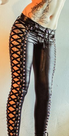 abandonedvillage:  TOXIC VISION BLACK WIDOW STUDDED LACE UP PANTS  http://www.facebook.com/toxicvisionclothing