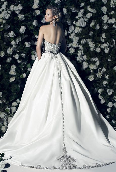 Brides: Victor Harper Couture. Strapless ballgown with embroidered natural waist bodice. Silk taffeta skirt with embroidered train.