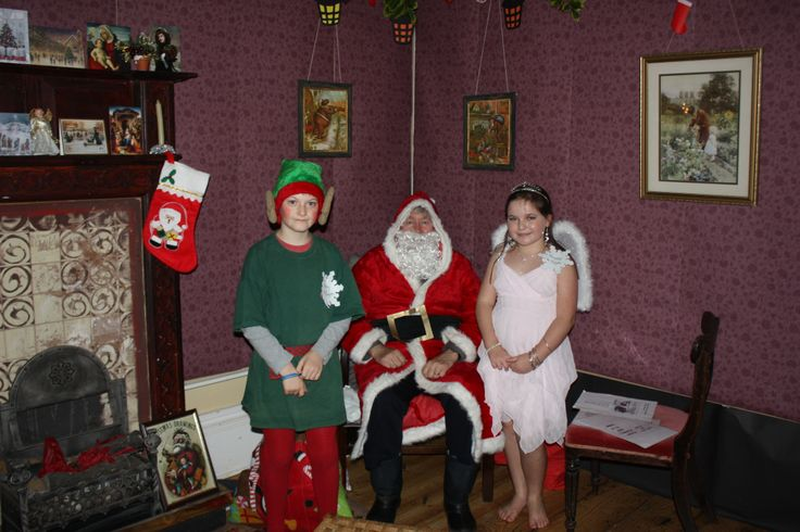Our wonderful elves with Santa in his Victorian parlour 21/12/13