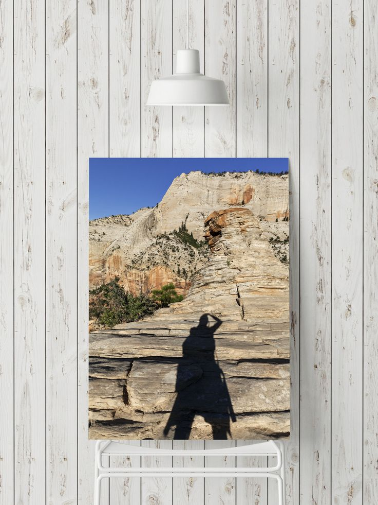 Art Print featuring the photograph Up on the Mountain by Evgeniya Lystsova. Shadow of Woman up on the mountain, Summit of Angel's Landing, Zion National Park, Utah. Wall Art - Landscape, Mountains, Nature, Travel Photography for your Home / Office Decor and Interior Design. Available as prints (framed, wood, acrylic, metal), canvas prints and posters. Plus, you can find Art Products that you like (tote bags, round beach towels, yoga mats, phone cases and more). #Landscape #HomeDecor #Prints