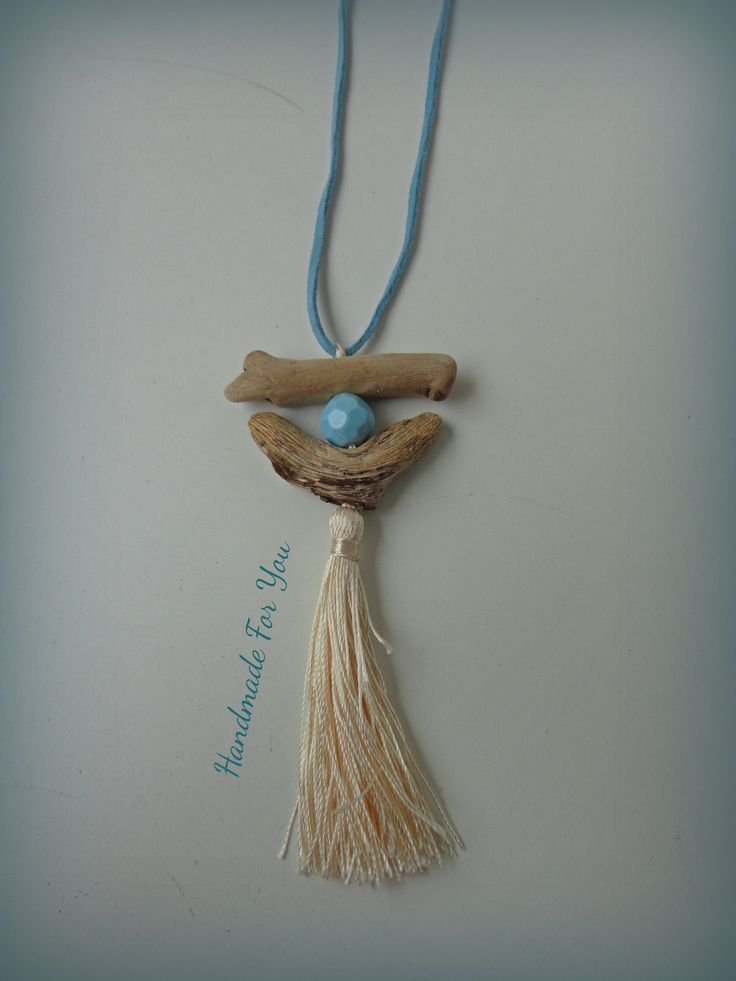 Long driftwood necklace with turquoise bead, tassel and leather