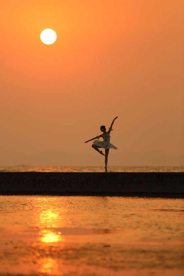 Dance on the beach like this girl when the sun is setting!  will be doing this next time i am at the beach