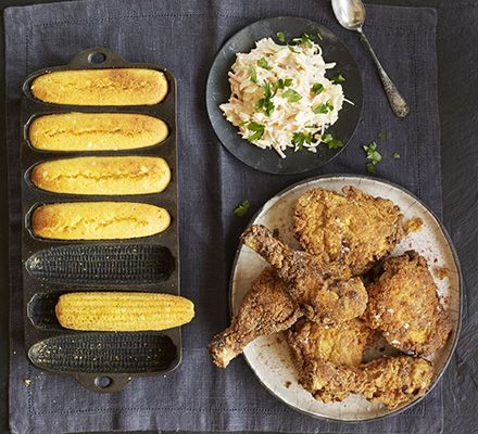 Soak chicken thighs and drumsticks in buttermilk, then coat in paprika and cayenne batter and fry. Serve with homemade southern-style bread
