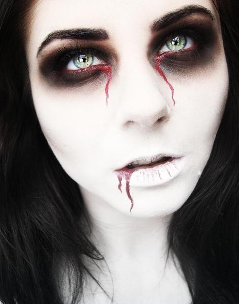 White face & black & bleeding eyes... x