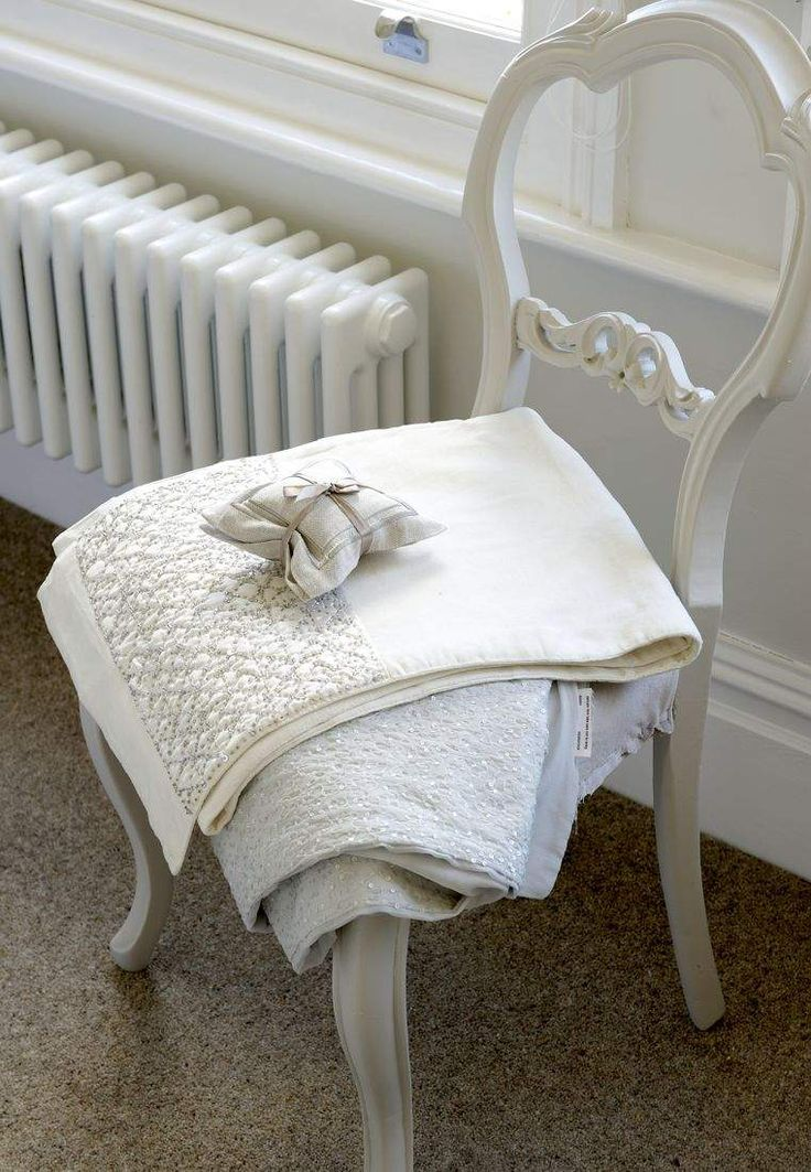 vintage cast iron radiator, painted antique chair and pure white beaded linens - The Paper Mulberry: Perfectly Pale