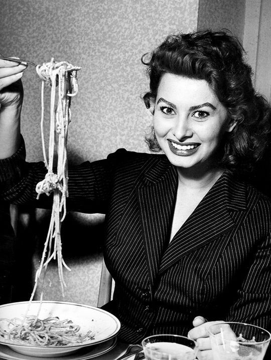 Sophia Loren eating spaghetti in a restaurant in Italy, 1953. Photo by Franco Fedeli