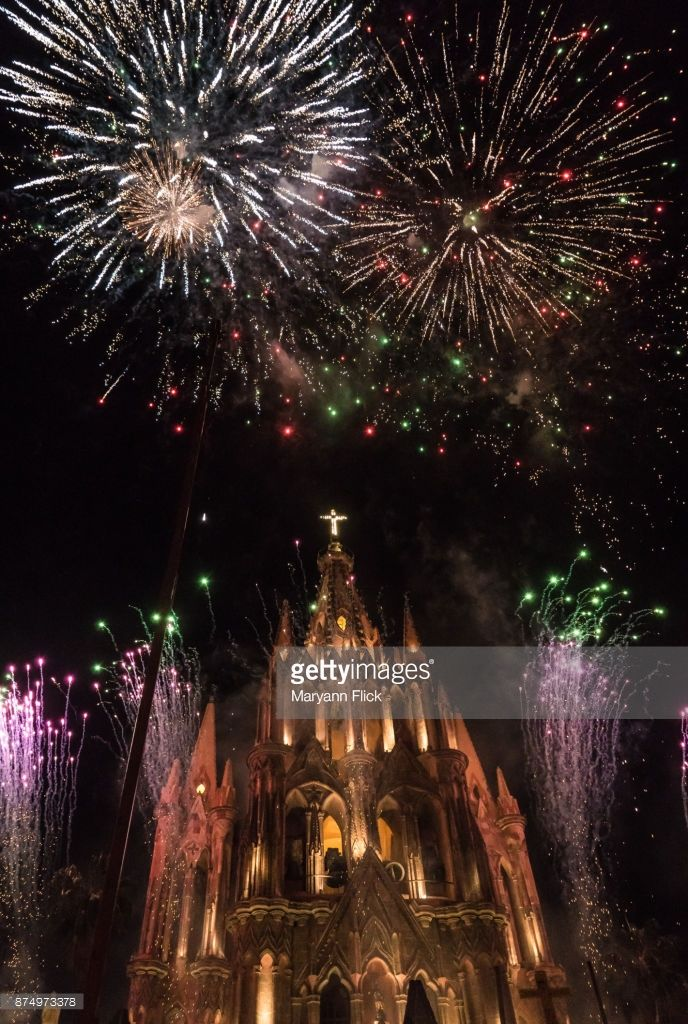 Aerial fireworks display above landmark church in San Miguel de Allende Mexico