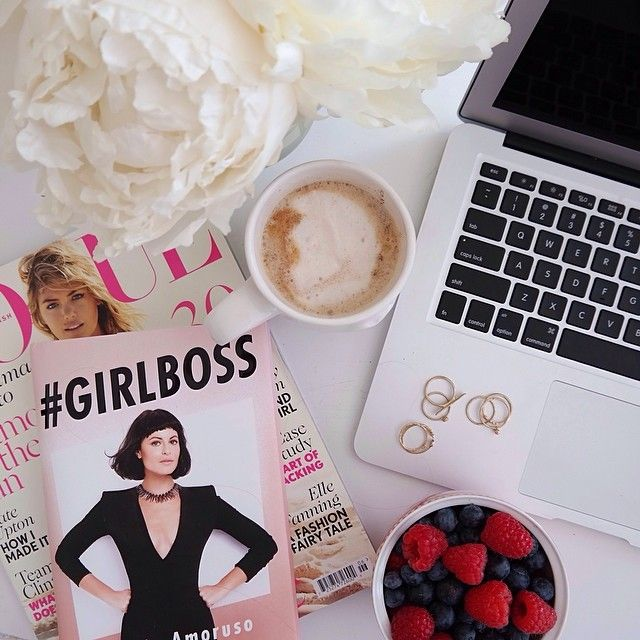 Desk scene this am: fresh fruit, new @janepopejewelry rings, peonies that have lasted over a week & a half, @britishvogue and a new book. Can't wait to crack open #GirlBoss this weekend! #tgif #deskscene #peonies #fruit #coffee