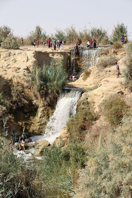 People enjoying the waterfalls at Wadi el Rayan. Fayum, Egypt.