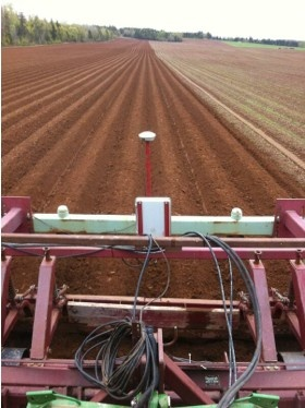 Hilling a new crop of PEI potatoes! Photo by Visser Spuds, PEI. http://www.peispuds.ca