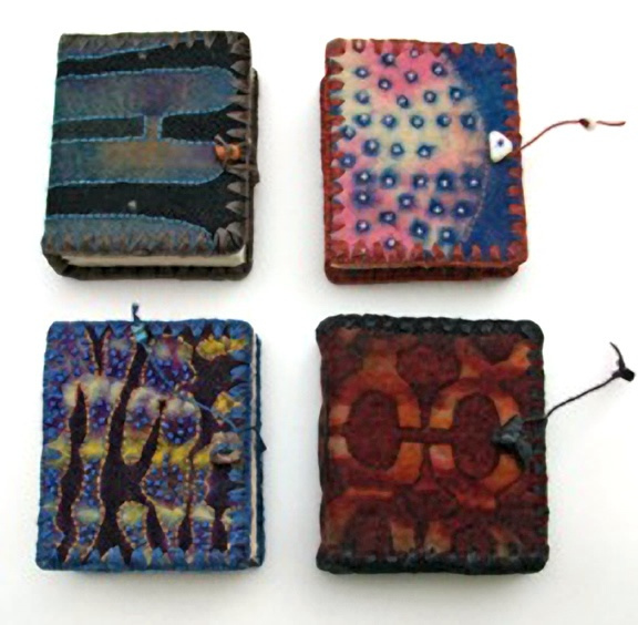 handmade books by Chad Alice Hagen, hand bound, resist-dyed felt covers