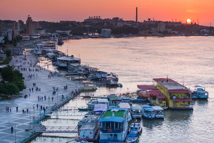 Sun setting over Tulcea port on the Danube. Image by Walter Bibikow / The Image Bank / Getty Images