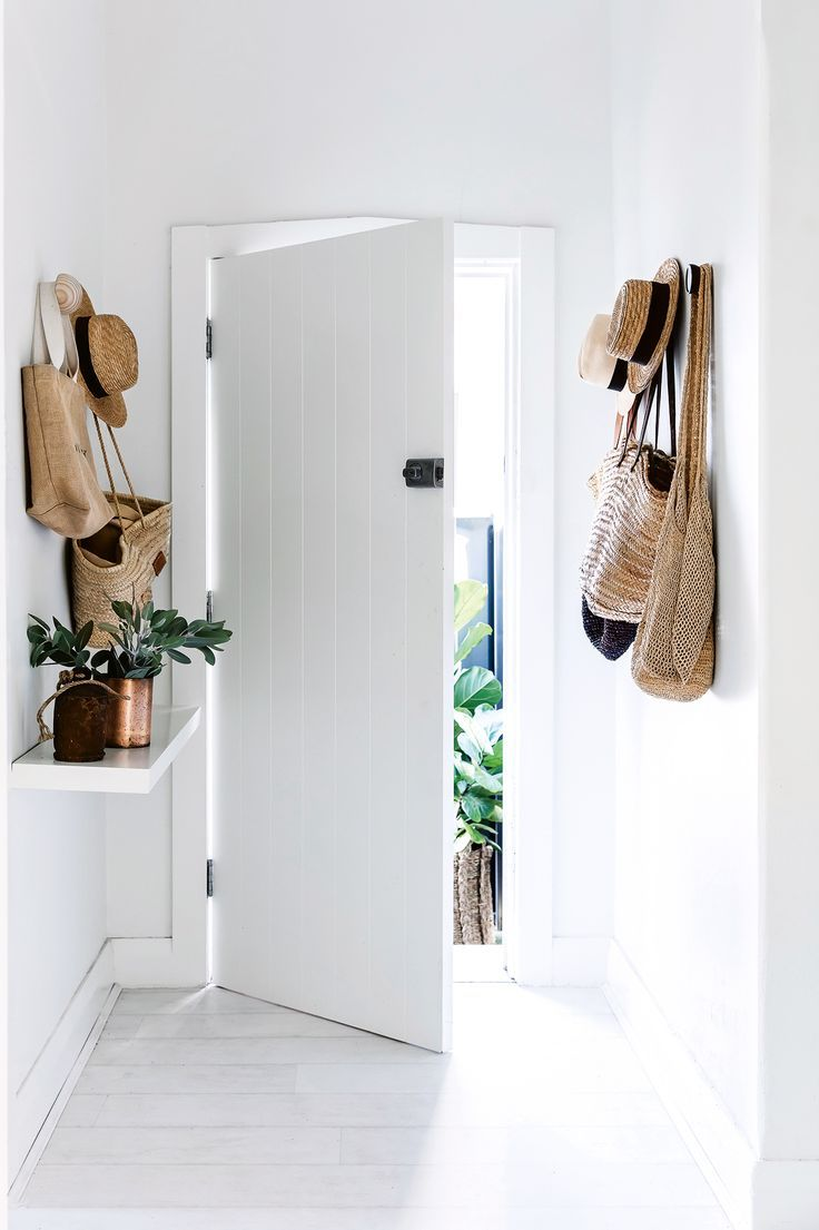Hats and bags by the door are a must near the beach. A wall-hung shelf acts as an entry console without taking up valuable floor space. This Bondi bungalow flows perfectly between indoor and outdoor. Photography by Maree Homer. Styling by Hande Renshaw. From the December 2017 issue of Inside Out Magazine. Available from newsagents, Zinio, https://au.zinio.com/magazine/Inside-Out-/pr-500646627/cat-cat1680012#/ and Nook.