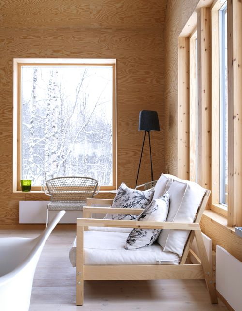 Add Some Warmth: 12 Plywood Interiors \\\ This stark plywood walled room in a home designed by PS Arkitektur seems the perfect place to contemplate the snowy weather.