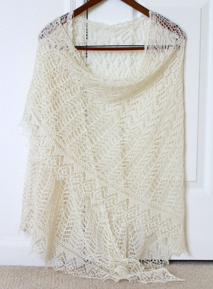 This hand knit wedding shawl is made with blend of 70% Baby Alpaca and 30% Mulberry Silk. The knitted lace is very delicate, soft and not itchy at all. The shawl has 4 different laced patterns through