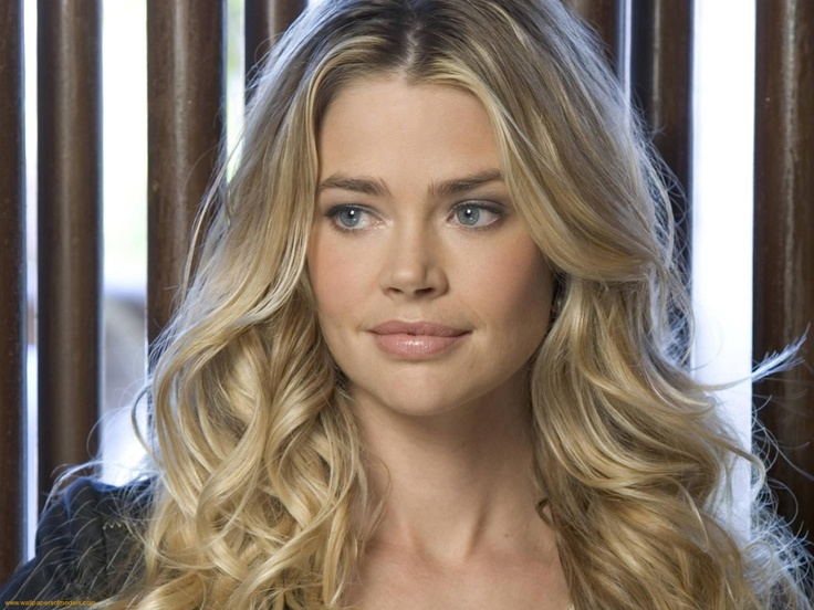 Denise Richards, she is an animal advocate like me which makes me love her more!  She has a lot of rescues!  :)