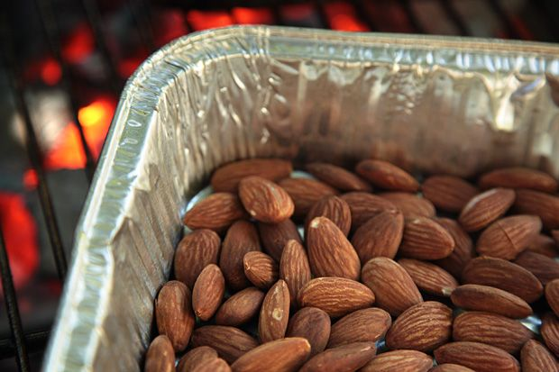 Smoked Almonds Recipe - CHOW Could do this on the smoker, 30 mins...