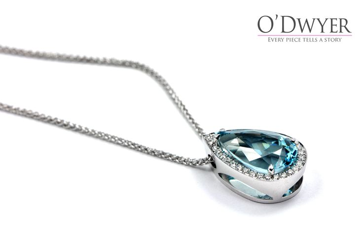 Unique Pendant - 18ct white gold pendant with an pear shaped Aquamarine and diamonds.