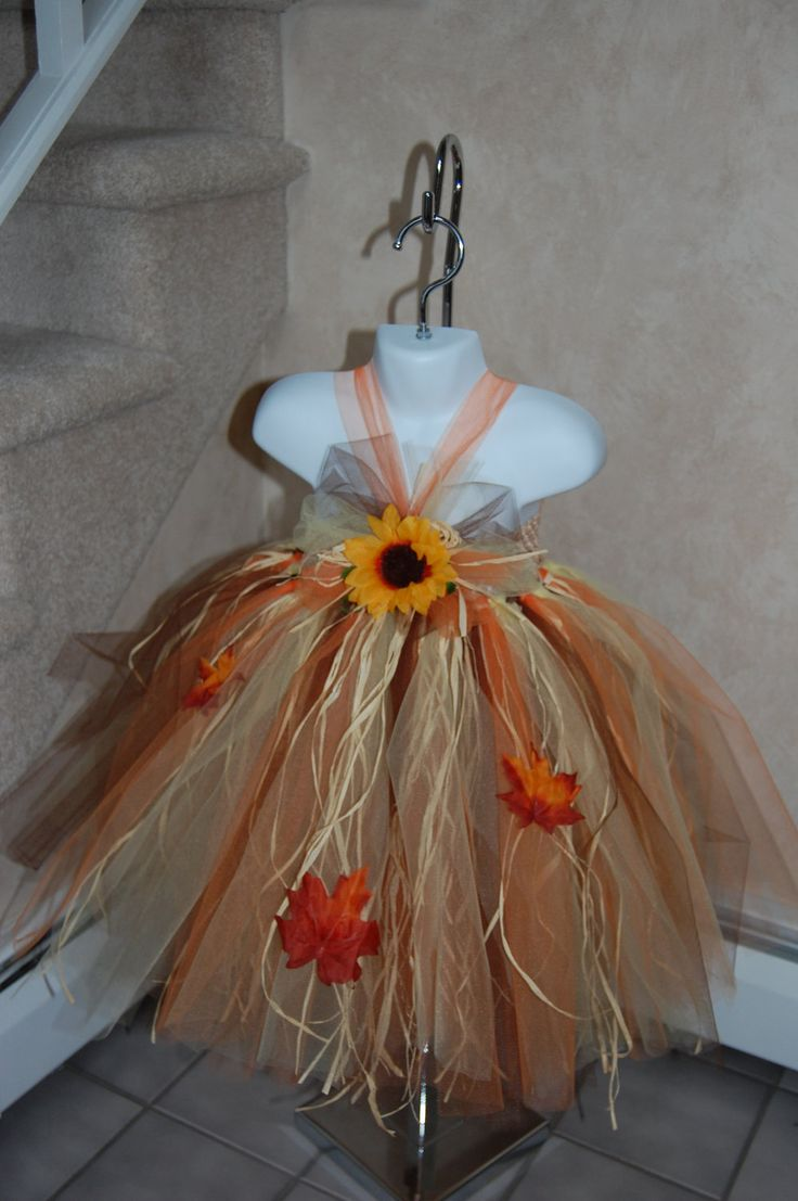 Scarecrow tutu dress. Crocheted top and with raffia . Flower and crow embellishments. $50.95, via Etsy.
