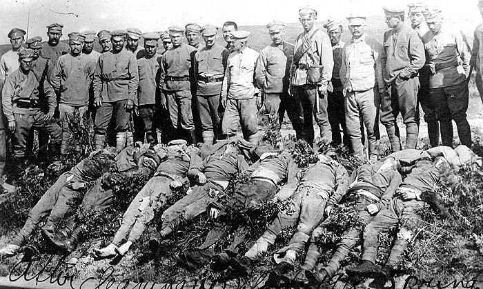 The Family Brichta - Survivors Stories www.HolocaustResearchProject.org - Wartime photo of Czech-Slovak soldiers standing over dead German soldiers