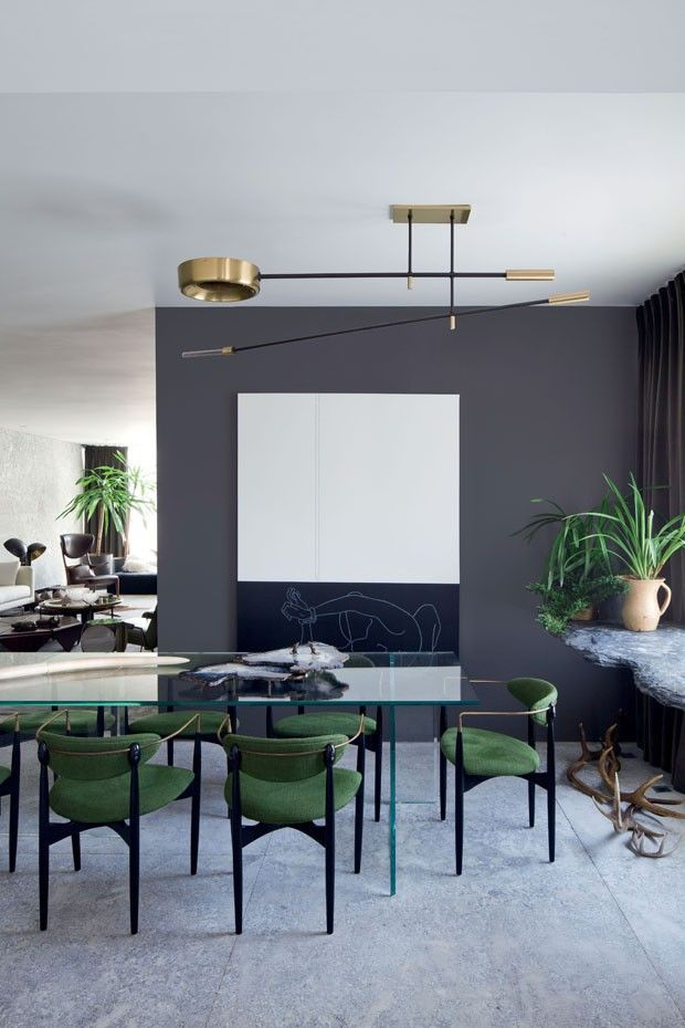 emerald seating + bursts of greenery mixed with a neutral charcoal palette