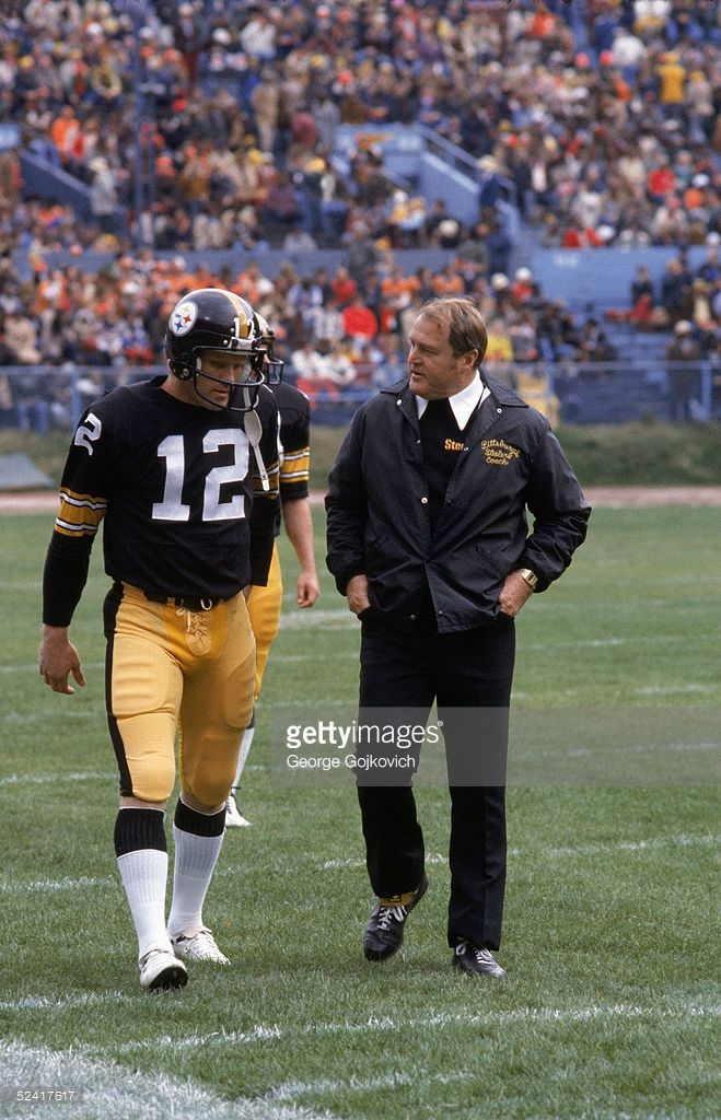 Quarterback Terry Bradshaw #12 and head coach <a gi-track='captionPersonalityLinkClicked' href=/galleries/search?phrase=Chuck+Noll&family=editorial&specificpeople=557986 ng-click='$event.stopPropagation()'>Chuck Noll</a> of the Pittsburgh Steelers walk off the field after the first half of an NFL game against the Cleveland Browns on October 15, 1978 at Municipal Stadium in Cleveland, Ohio.